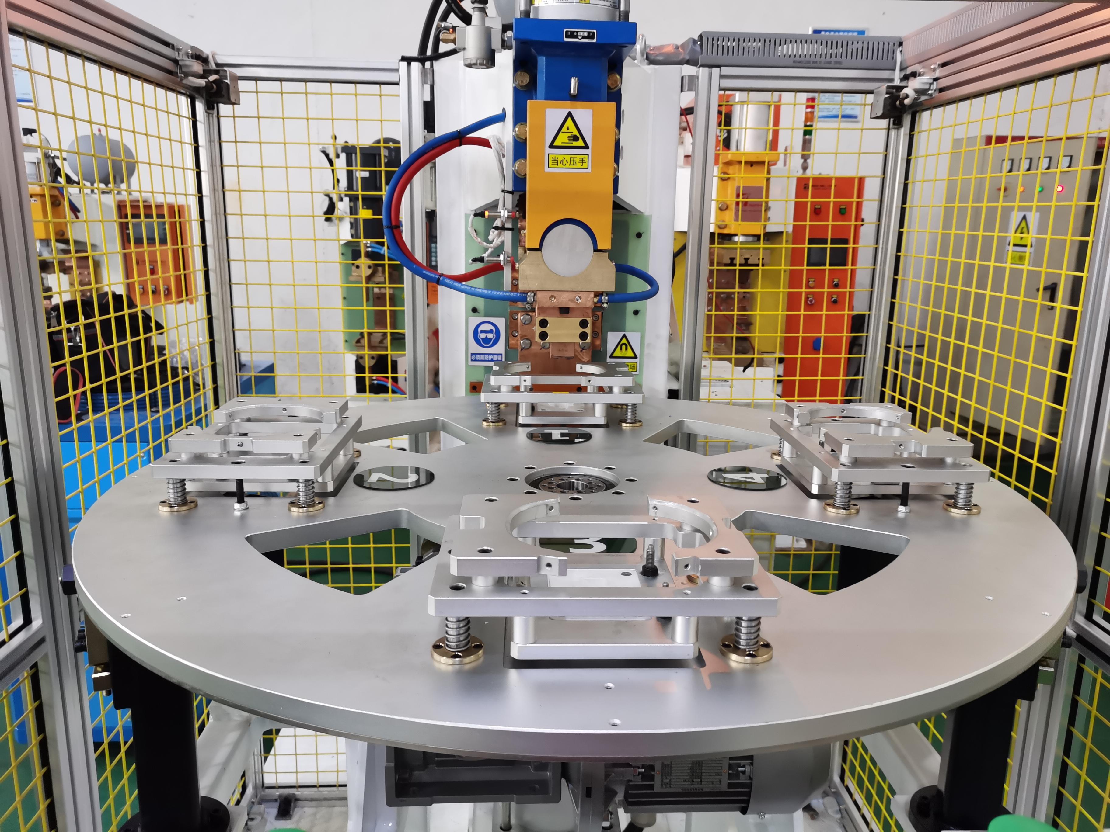 压缩机壳体支架四工位凸焊机项目介绍